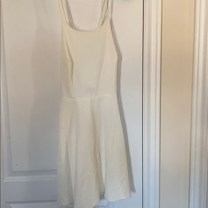 Lulu's white dress with scalloped detail
